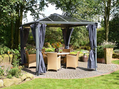 Image of Opened Palermo Gazebo Curtain Set - 4 Piece installed in a gazebo - in a garden