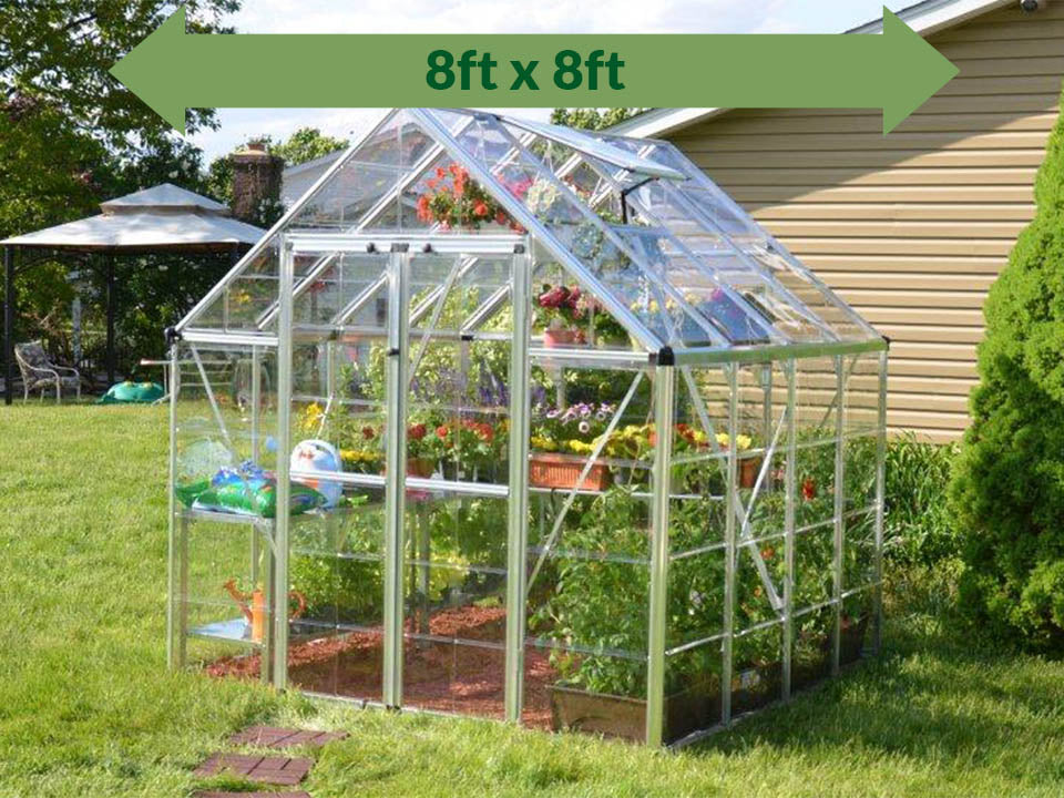 Palram 8ft x 8ft Snap & Grow Hobby Greenhouse - HG8008 - full view - in a garden - with a green arrow on top