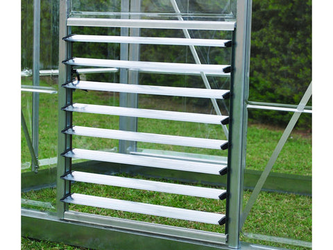 Image of Open Palram Side Louver Window - attached to an empty greenhouse