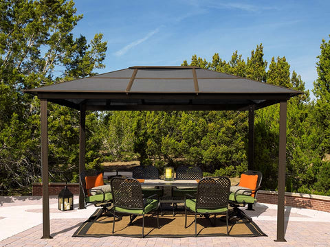 A dining set under Paragon Madrid 10ft x 13ft Hard Top Gazebo