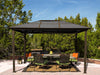Image of A dining set under Paragon Madrid 10ft x 13ft Hard Top Gazebo