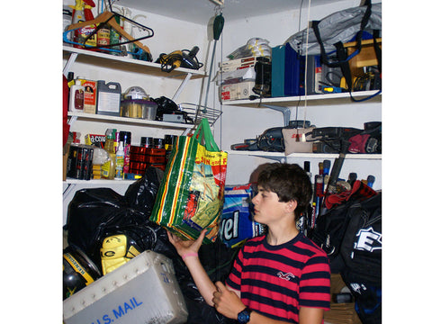 Hanging bags in a storage room using Plant Caddie Hook