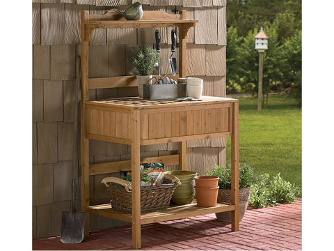 Potting Bench with Recessed Storage beside a wall