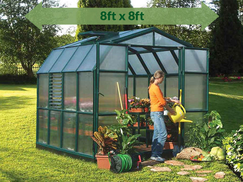 Image of Rion Prestige 2 Twin Wall 8ft x 8ft Greenhouse HG7308-full view - green arrow on top  with dimensions  - in a garden