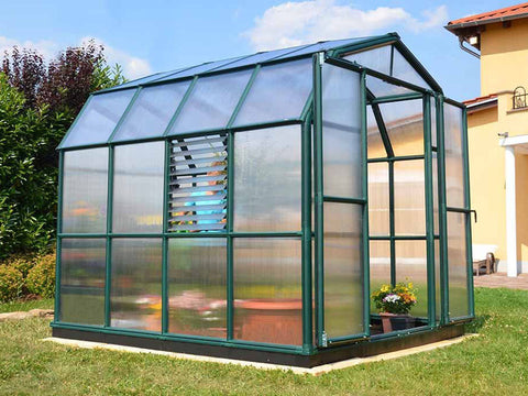 Image of Rion Prestige 2 Twin Wall 8ft x 8ft Greenhouse HG7308 - side view - open door - in a garden