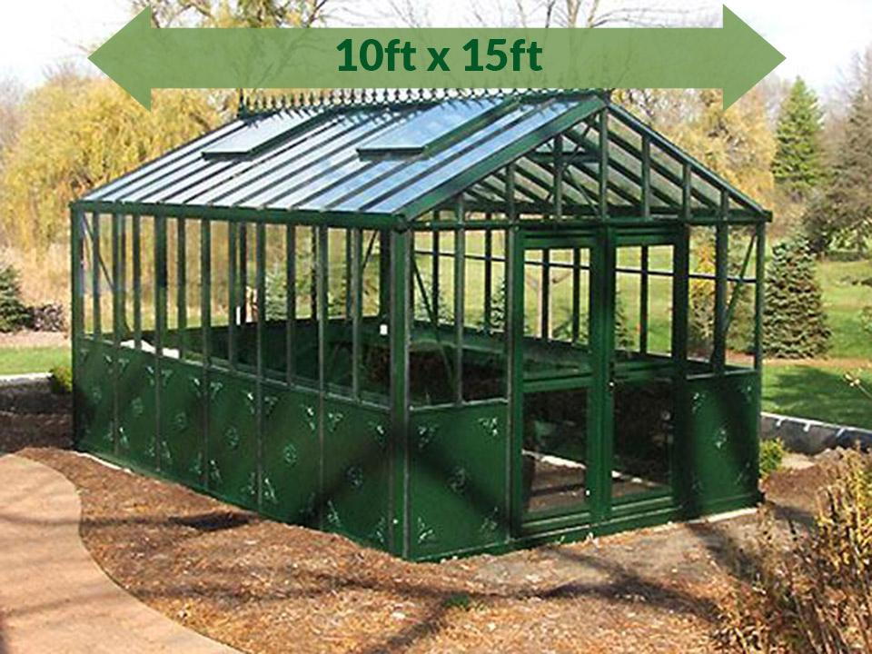 Bare Janssens Retro Royal Victorian VI34 Greenhouse 10ft x 15ft - full view - in a garden - green arrow on top showing dimensions