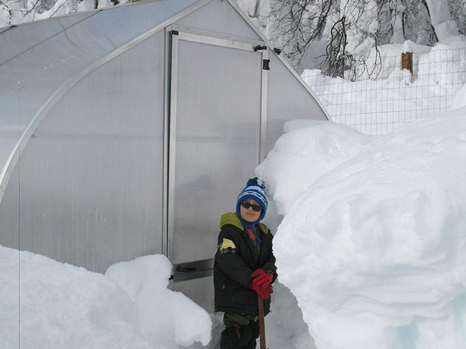The Hoklartherm Riga 2s Greenhouse 7.8x7 in winter with loads of snow