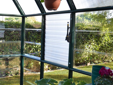 Closed Rion Side Louver Window installed in a greenhouse