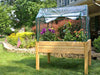 Image of Riverstone Eden Mini Greenhouse in a garden