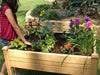 Image of Riverstone Eden Mini Greenhouse - Growing bed -  a girl standing by the growing bed
