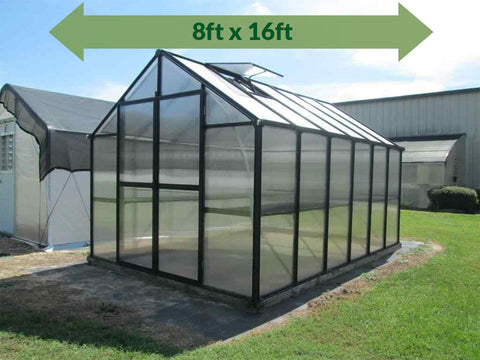 Image of Riverstone Monticello Greenhouse 8x16 - full view - green arrow on top showing dimensions