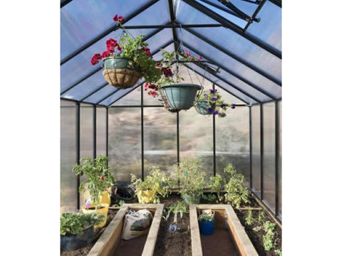 Riverstone Monticello Greenhouse 8x24 - interior view with plants and flowers