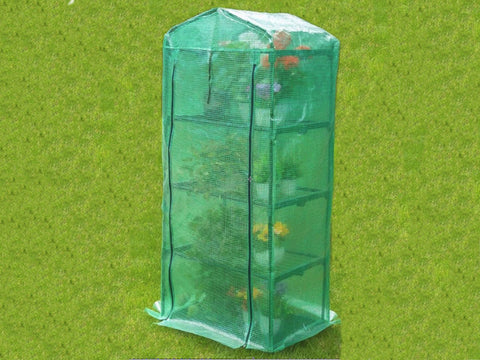 Image of Genesis Portable Rolling Greenhouse with closed opaque cover and plants inside placed on a garden