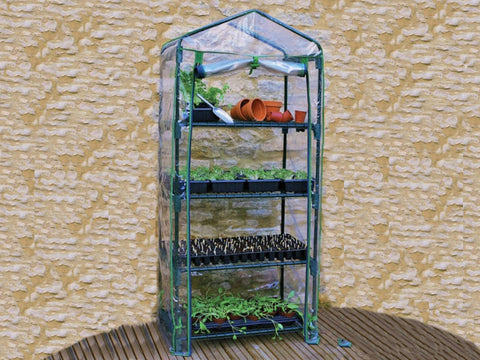 Image of Genesis Portable Rolling Greenhouse with open clear cover and plants and pots inside