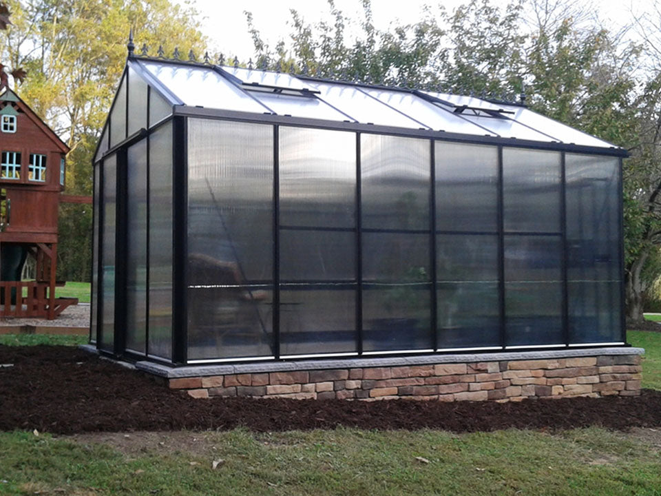 Janssens Royal Victorian VI34 Greenhouse 10ft x 15ft with polycarbonate covering on a stem wall