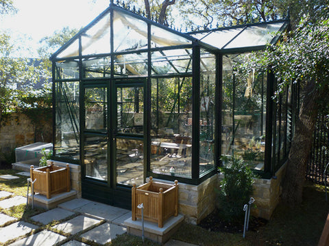 Front view of the Janssens T-Shaped Royal Victorian Orangerie 10ft x 16ft set up in a garden