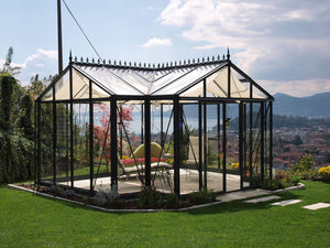Janssens T-Shaped Royal Victorian Orangerie 10ft x 16ft in a garden with great view of mountains and a lake