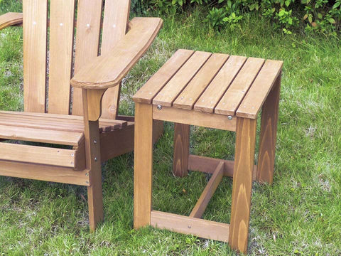 Wooden utility Side table beside an adirondack chair