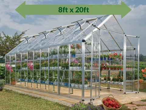 Image of Palram 8ft x 20ft Snap & Grow Hobby Greenhouse - HG8020 - full view - with arrow on top - in a garden set up