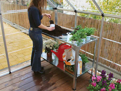 Image of Steel Work Bench HG2001 - inside a greenhouse - with a woman gardening