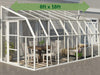 Image of Rion 8ft x 18ft Sun Room 2 Greenhouse - HG7618 - full view - by the wall - green arrow on top