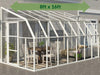 Image of Rion 8ft x 16ft Sun Room 2 Greenhouse - HG7616 - full view - by the wall - green arrow on top