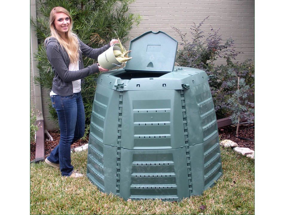 A woman on the left side pouring dried corns into the Thermo Star Jumbo Composter