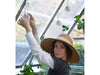 Image of Trellising Kit Pro for the Palram and Rion Greenhouses-  HG1024 -  a woman arranging the trellis