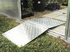 Hoklartherm Wheelbarrow Access Plate at the entrance of a greenhouse