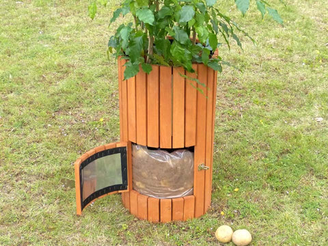 Open side door of Wooden Potato Planter with growing potatoes inside