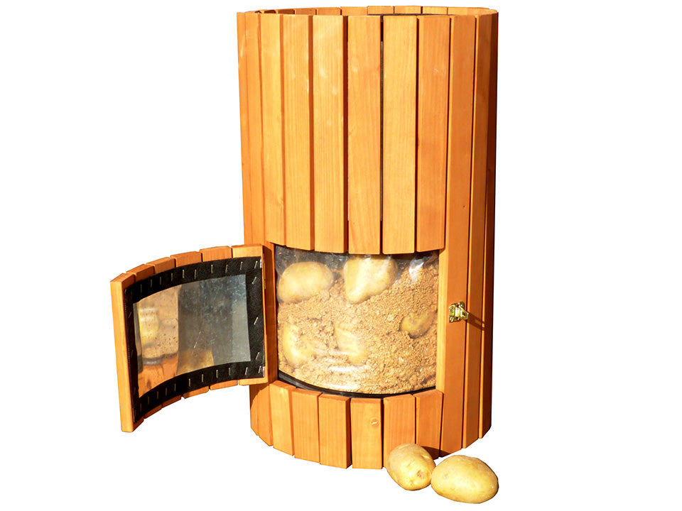 Open side door of Wooden Potato Planter with harvested potatoes