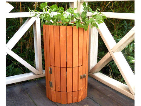 Image of Closed side door of Wooden Potato Planter placed in a corner