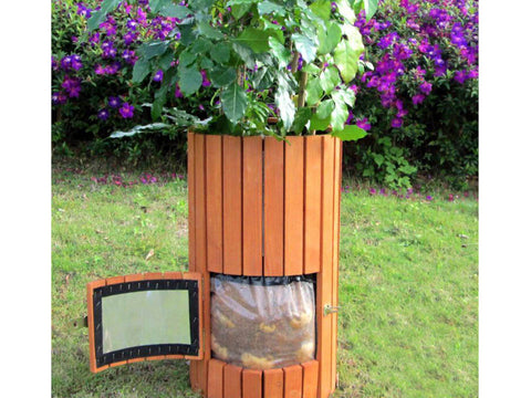 Wooden Potato Planter with open side door and potatoes inside
