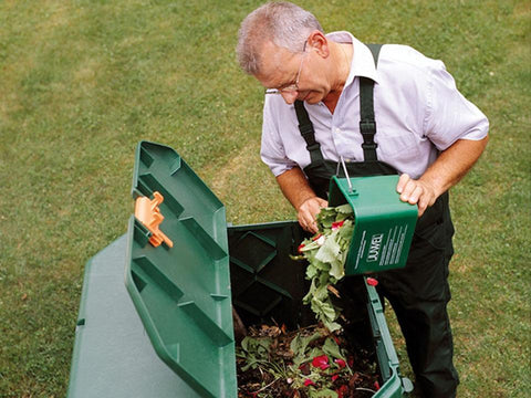 Image of Easy to Use. Man pouring organic materials into the Aeroquick Composter
