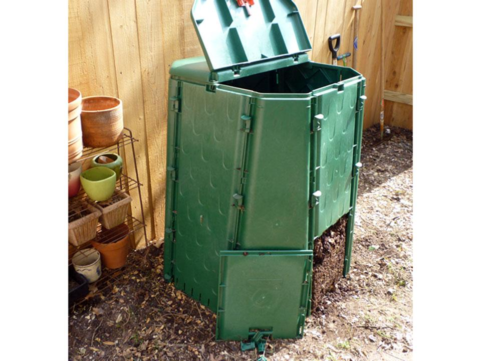 Remove usable compost from the easy opening bottom door of the Aeroquick Composter