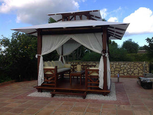 Front view of Handcrafted Balinese Solid Wood Gazebo installed in the garden