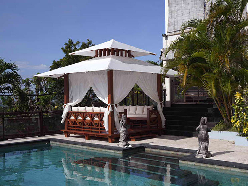 Front and side view of Handcrafted Balinese Solid Wood Gazebo by the pool
