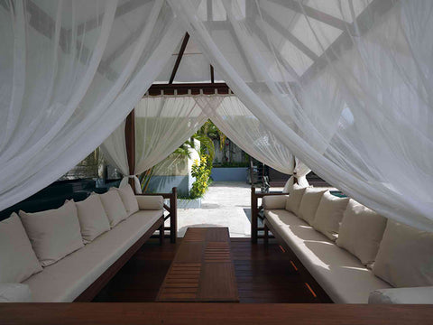 Image of Interior view of Handcrafted Balinese Solid Wood Gazebo with bench, cushions, pillows and tied mosquito nettings