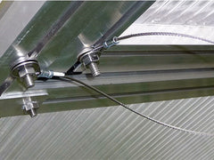 Riga Roof Window Wind Restraint System installed on window