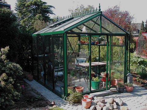 Image of Janssens Royal Victorian VI 23 Greenhouse 8ft x 10ft used as a wintergarden with seating area