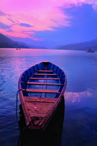 Boat At Phewa Tal Lake in Pokhara Nepal by Jeffry Juel