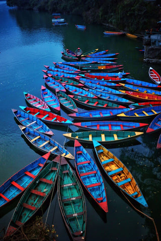 Boats At Phewa Tal Lake in Pokhara Nepal by Jeffry Juel