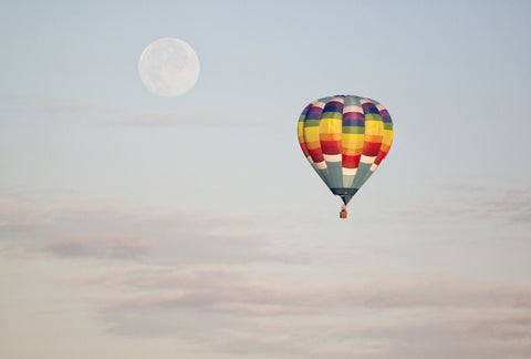 Colorful Hot Air Balloon In The Sky With Moon In The Background