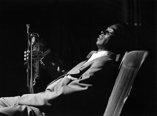 Photograph of Jazz Legends - Miles Davis Resting Backstage At Shrine Auditorium 1950 - Tallenge Music Collection by Stephen Marks