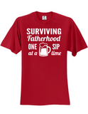 Surviving Fatherhood One Sip At A Time T-Shirt