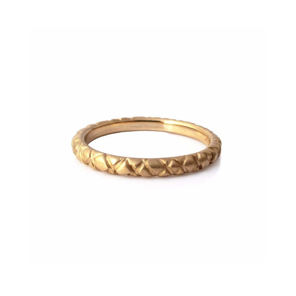 Quilted band crafted in 14KT yellow gold.