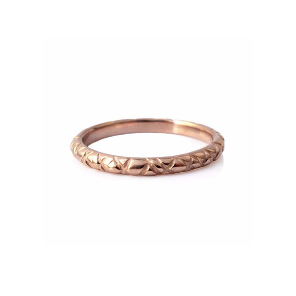 Quilted band crafted in 14KT rose gold.