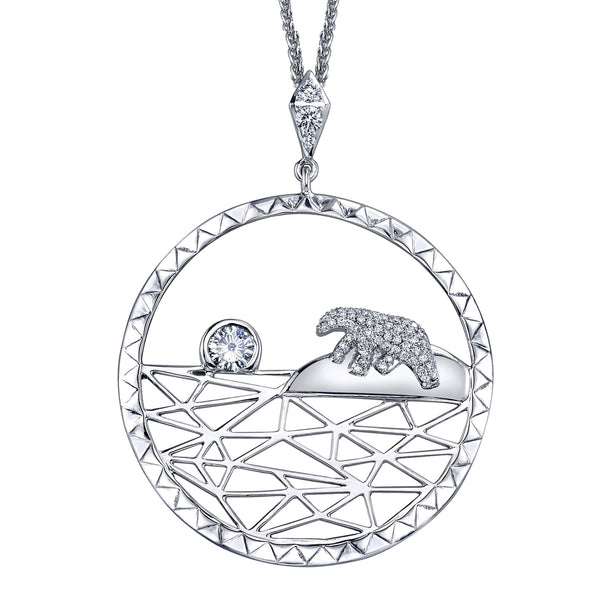 Crafted in 14KT white Certified Canadian Gold, this pendant features a diamond set polar bear and a round brilliant-cut Canadian diamond sun on an icy landscape.