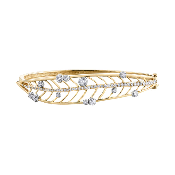 Crafted in 14KT yellow Certified Canadian Gold, this bangle bracelet features a large willow tree leaf set with round brilliant-cut Canadian diamonds.