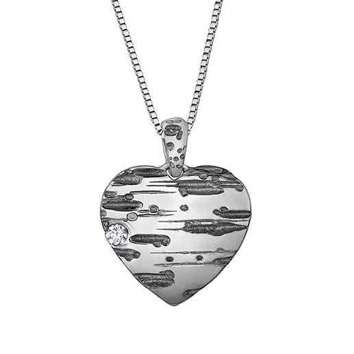 Crafted in 14KT Certified Canadian Gold, this heart shape pendant features a birch bark pattern with black rhodium details and a round brilliant-cut Canadian diamond.